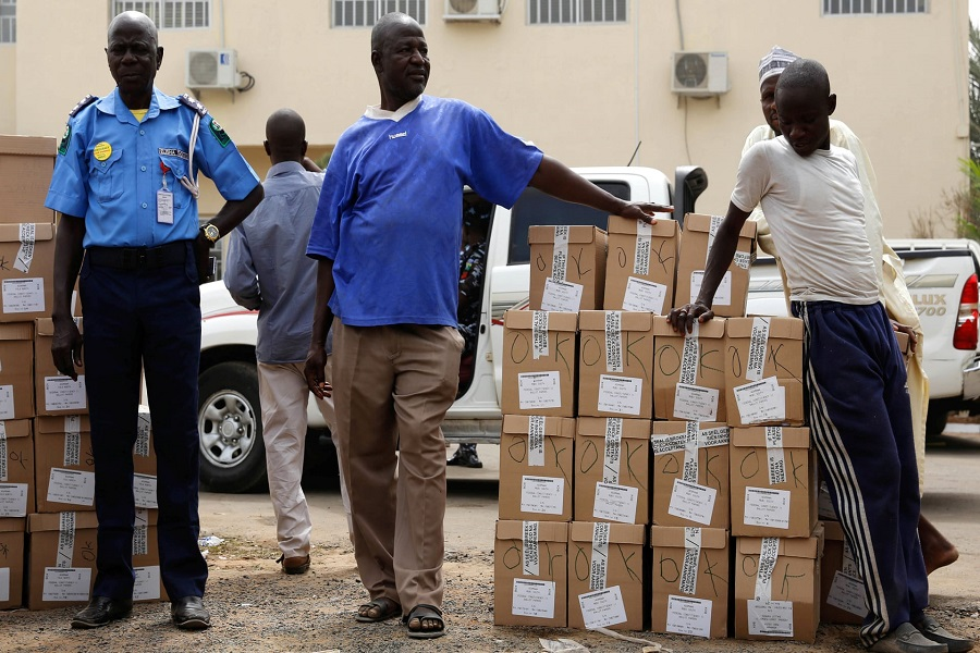 Ad-hoc staff wait to load election materials onto a truck for distribution in Yola, in Adamawa State, Nigeria. Photograph: Nyancho Nwanri/Reuters