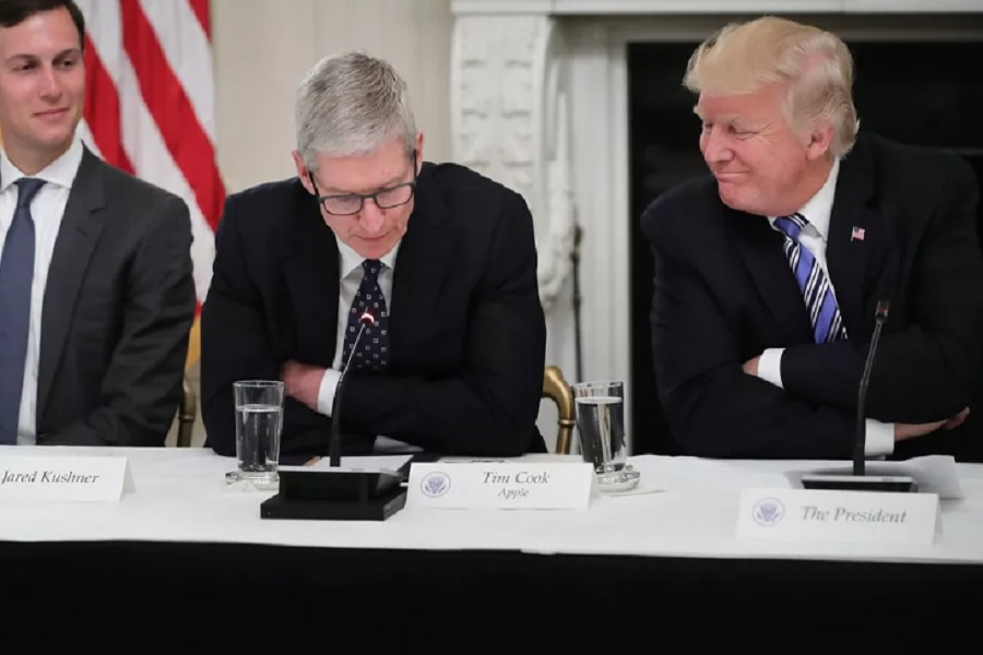 Apple CEO Tim Cook sits next to Trump at a meeting of the American Technology Council in the White House in June 2017. Chip Somodevilla/Getty Images