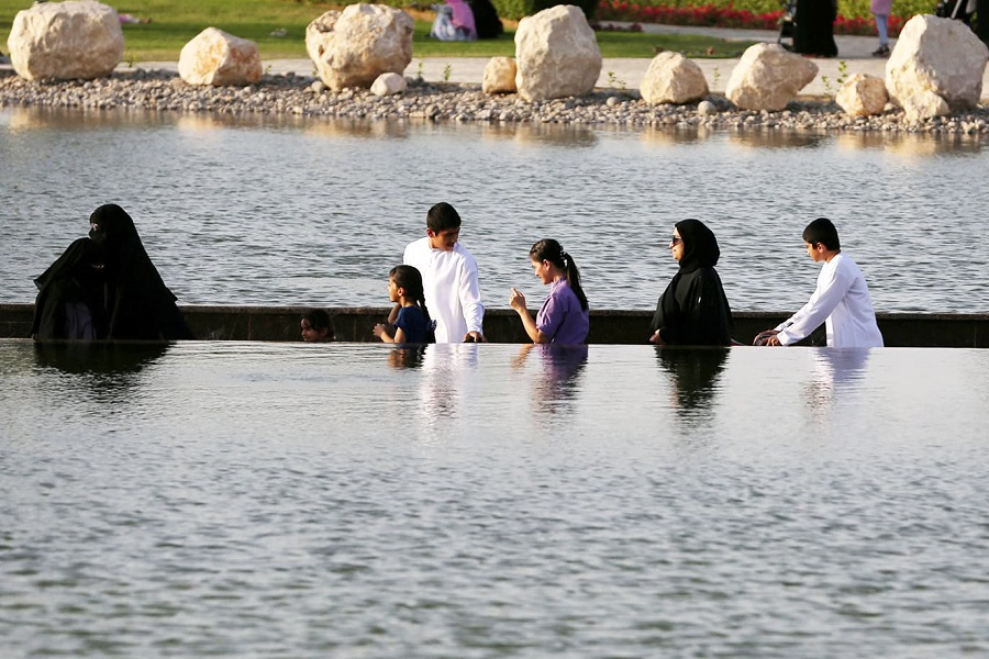 Visitors are seen crossing the lake at Dubai's Quranic Park in Dubai, UAE April 6, 2019. Picture taken April 6, 2019. REUTERS/Satish Kumar