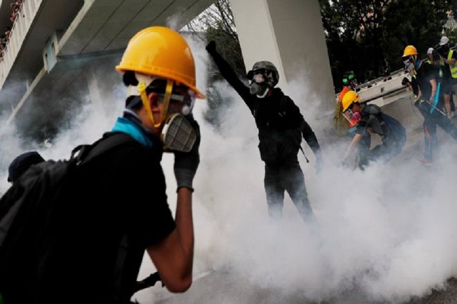 REUTERS Image caption Police fired tear gas in an attempt to disperse the protesters